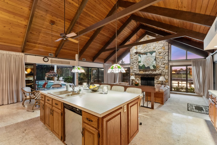 Real Estate Photography - 3220 Rum Row, Naples, FL, 34102 - Family Room / Kitchen