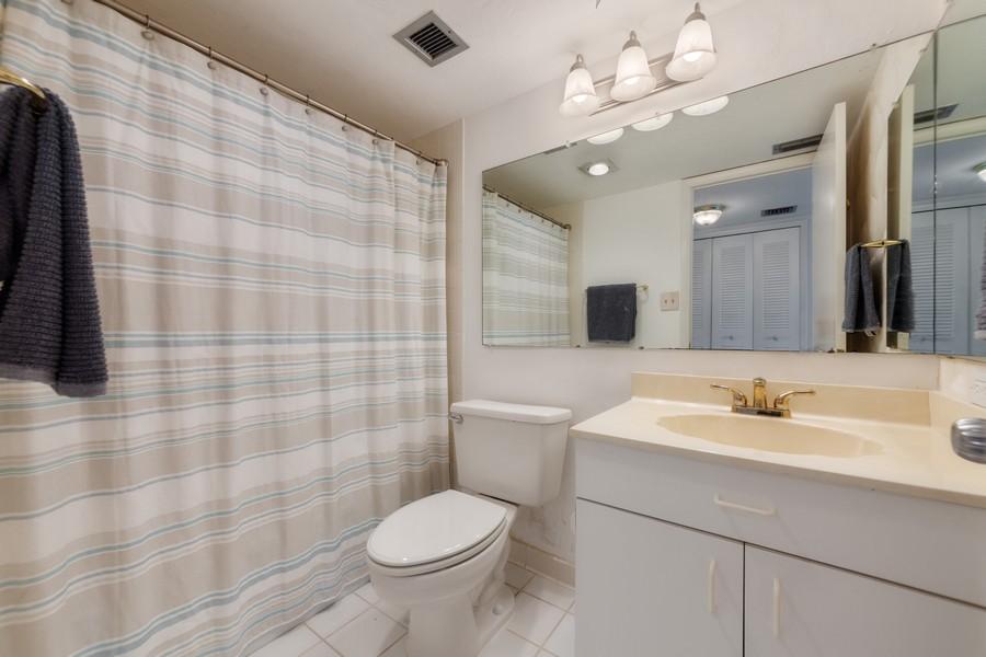 Real Estate Photography - 4280 SE 20th Pl, Unit 702, Cape Coral, FL, 33904 - Master Bathroom