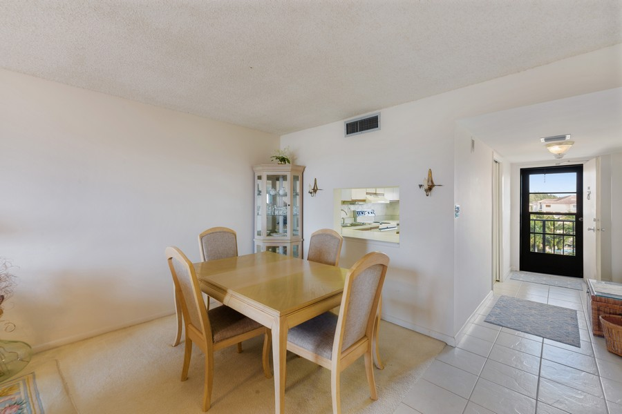 Real Estate Photography - 4280 SE 20th Pl, Unit 702, Cape Coral, FL, 33904 - Dining Room