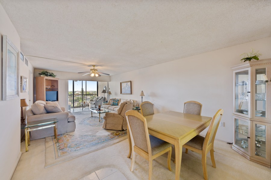 Real Estate Photography - 4280 SE 20th Pl, Unit 702, Cape Coral, FL, 33904 - Living Room / Dining Room