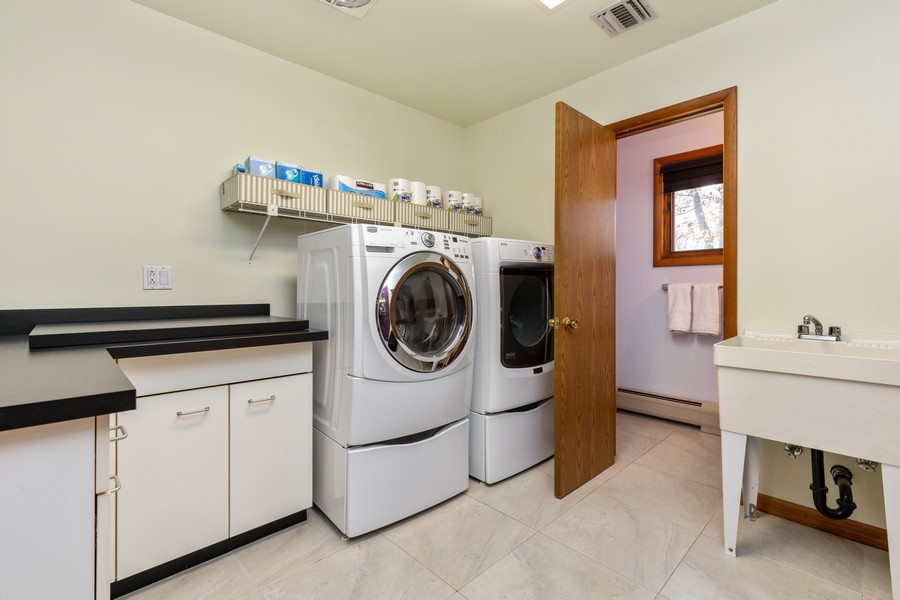 Real Estate Photography - 65 Rosman Rd, Thiells, NY, 10984 - Laundry/Mudroom w/ Folding Counter & Stove Top Gri