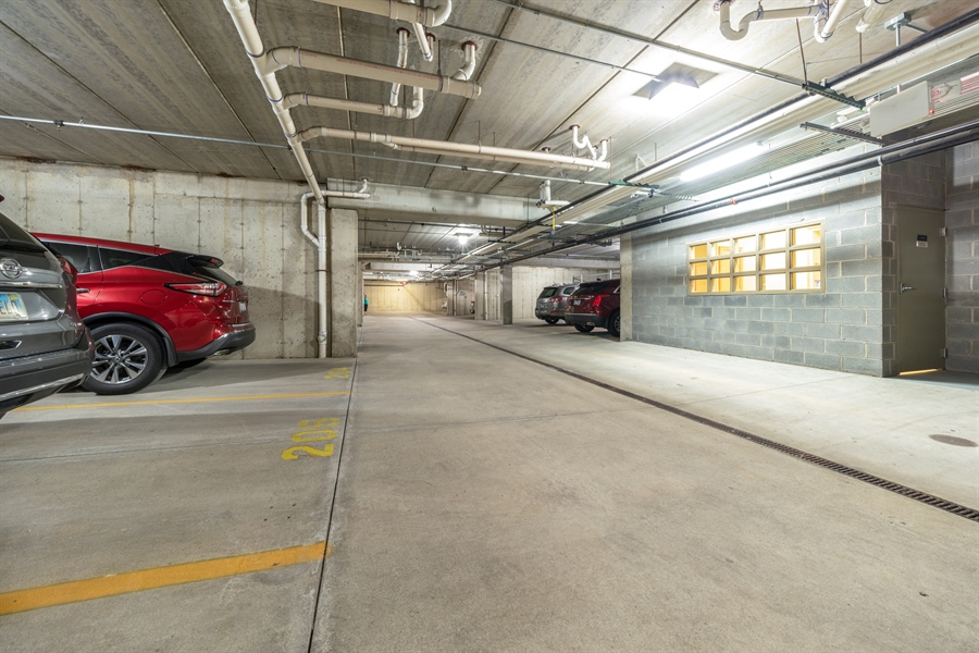 Real Estate Photography - 271 E Railroad Ave, 105, Bartlett, IL, 60103 - Parking Garage