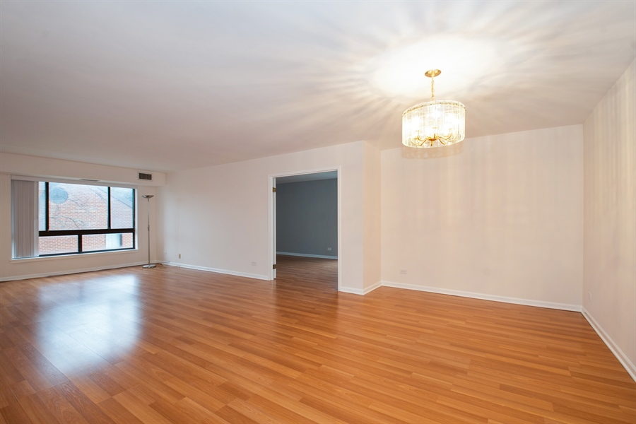 Real Estate Photography - 600 Naples Ct, 210, Glenview, IL, 60025 - Living Room / Dining Room