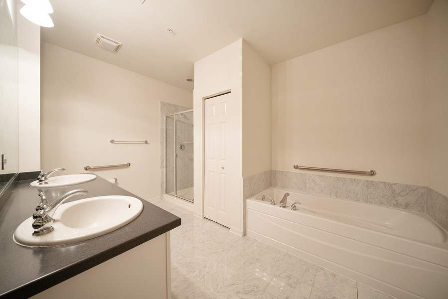 Real Estate Photography - 267 E Railroad Ave, Unit 101, Bartlett, IL, 60103 - Master Bathroom