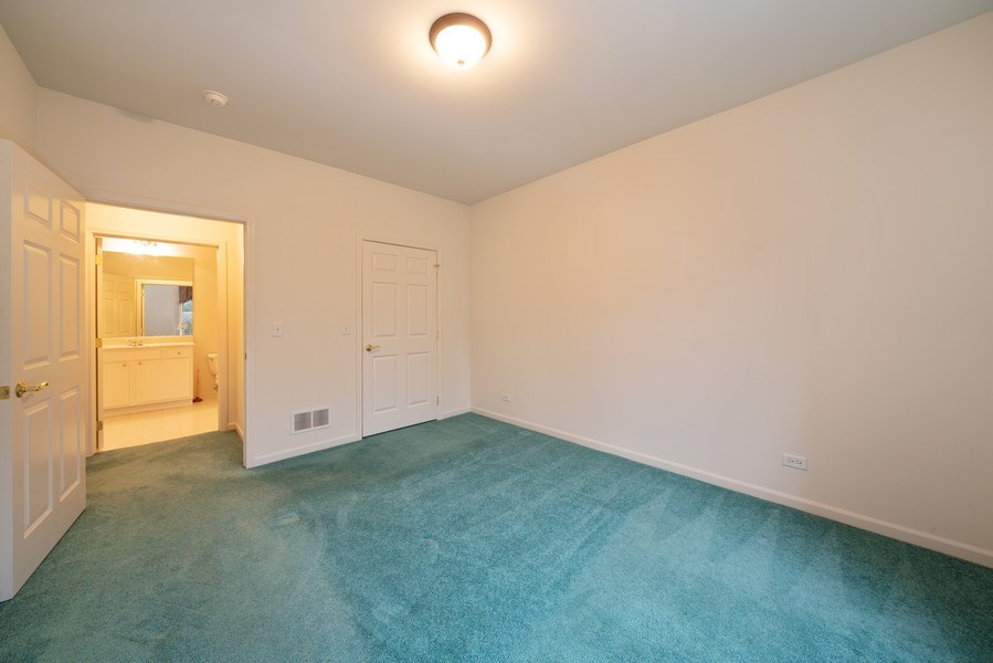 Real Estate Photography - 267 E Railroad Ave, Unit 101, Bartlett, IL, 60103 - 2nd Bedroom