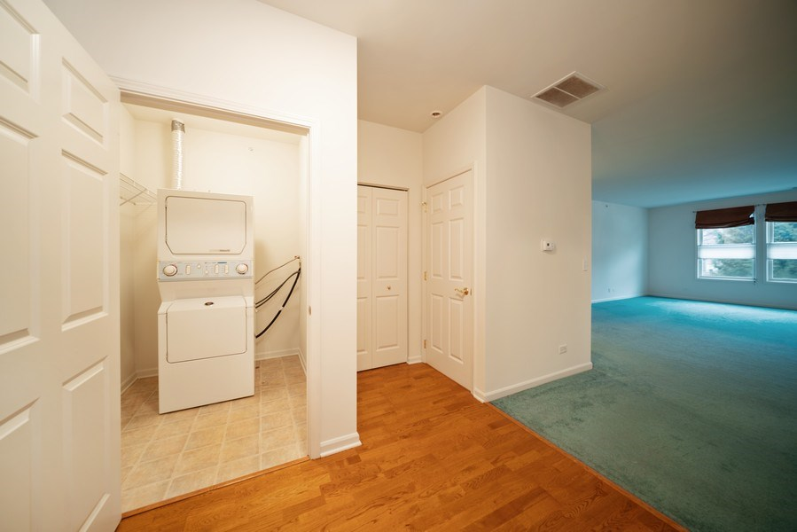 Real Estate Photography - 267 E Railroad Ave, Unit 101, Bartlett, IL, 60103 - Laundry Room