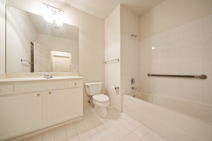 Real Estate Photography - 267 E Railroad Ave, Unit 101, Bartlett, IL, 60103 - 2nd Bathroom