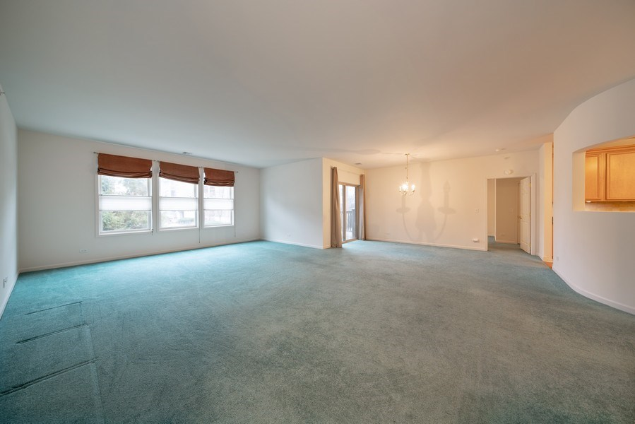 Real Estate Photography - 267 E Railroad Ave, Unit 101, Bartlett, IL, 60103 - Living Room / Dining Room