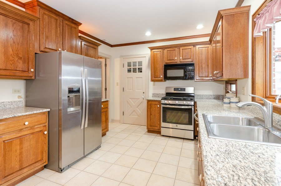 Real Estate Photography - 1109 Logan Ave, Elgin, IL, 60120 - Kitchen