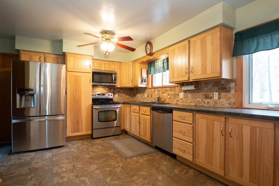 Real Estate Photography - 21209 E US Highway 14, Harvard, IL, 60033 - Kitchen