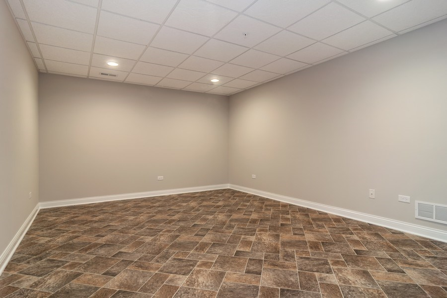 Real Estate Photography - 214 donmor dr, bloomingdale, IL, 60108 - Bedroom in the basement