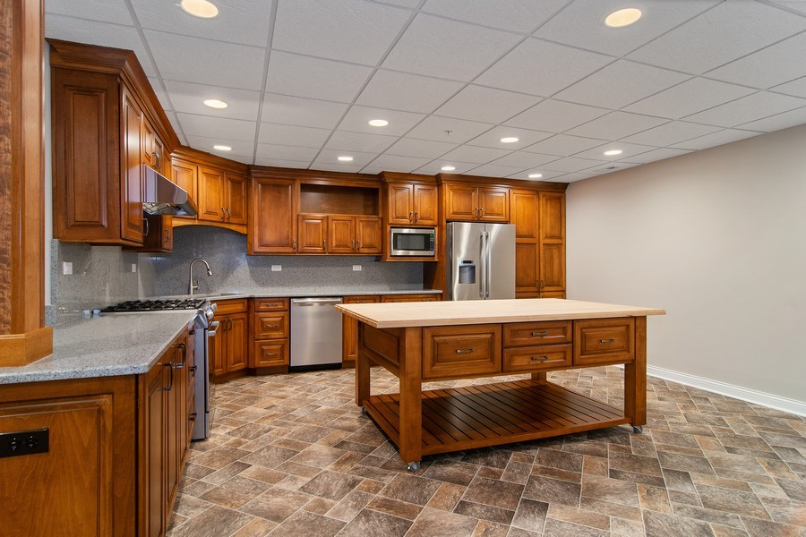 Real Estate Photography - 214 donmor dr, bloomingdale, IL, 60108 - Second kitchen located in the basement