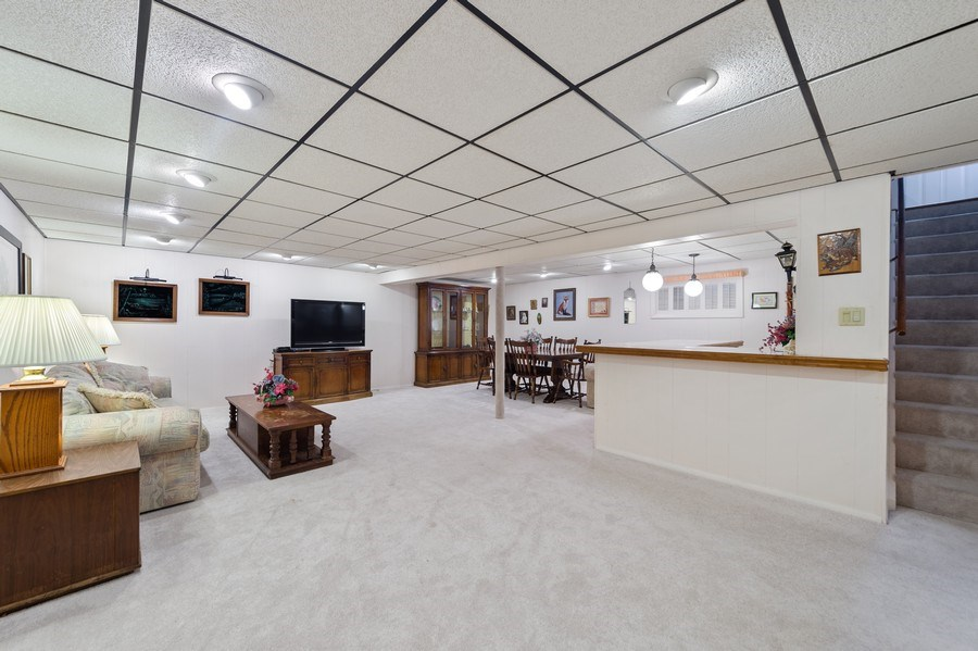 Real Estate Photography - 1425 S Robert Dr, Mount Prospect, IL, 60056 - Basement - Bedroom, Full Bath, Office, Laundry and