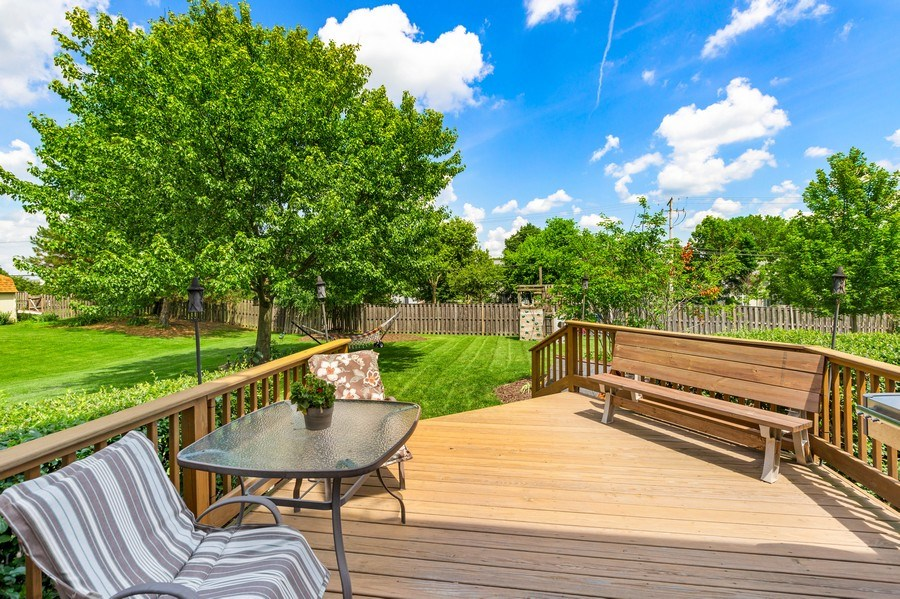 Real Estate Photography - 235 Farmhill Dr, Algonquin, IL, 60102 - KITCHEN SLIDERS LEAD TO DECK