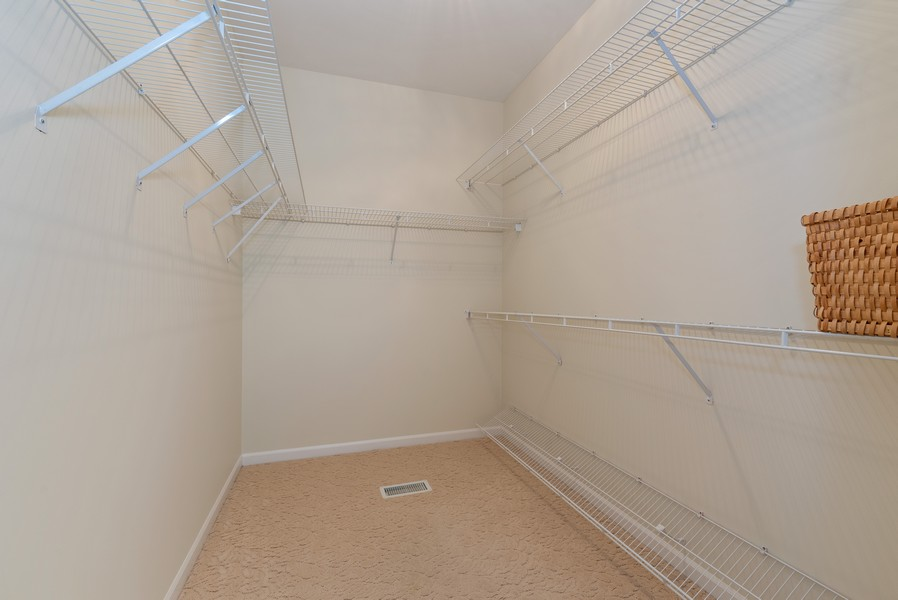 Real Estate Photography - 1344 Winslow Circle, Woodstock, IL, 60098 - Master Bedroom Closet