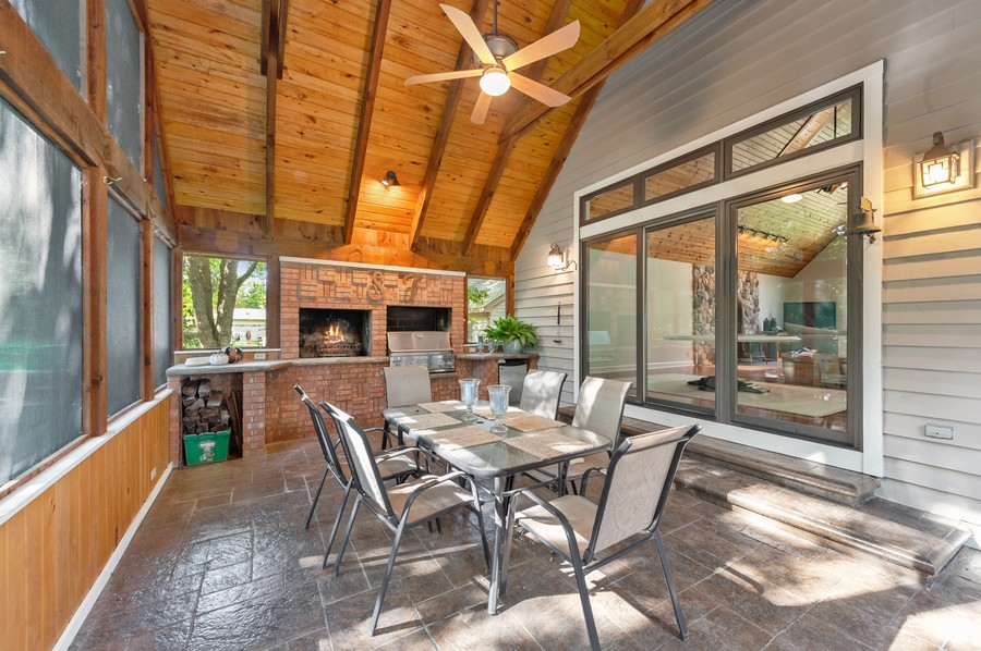 Real Estate Photography - 2415 Colby Drive, McHenry, IL, 60050 - Screened Porch with view of fireplace, grill and r