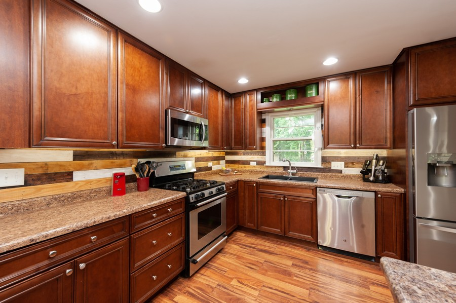 Real Estate Photography - 4705 Gregory St, Johnsburg, IL, 60051 - Kitchen