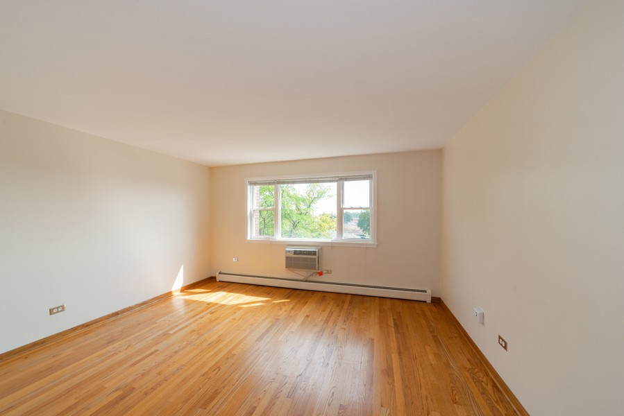 Real Estate Photography - 4600 Cumberland, Unit 409, Chicago, IL, 60656 - Living Room