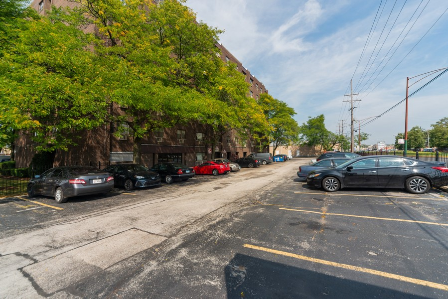 Real Estate Photography - 4600 Cumberland, Unit 409, Chicago, IL, 60656 - Parking Area