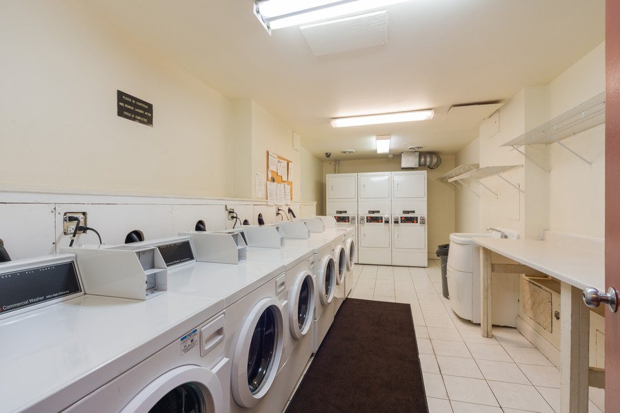 Real Estate Photography - 4600 Cumberland, Unit 409, Chicago, IL, 60656 - Laundry Room