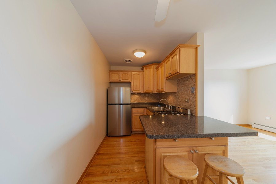 Real Estate Photography - 4600 Cumberland, Unit 409, Chicago, IL, 60656 - Kitchen