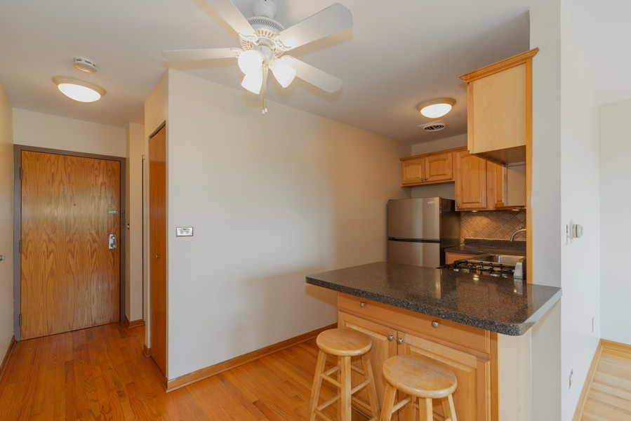 Real Estate Photography - 4600 Cumberland, Unit 409, Chicago, IL, 60656 - Breakfast Nook