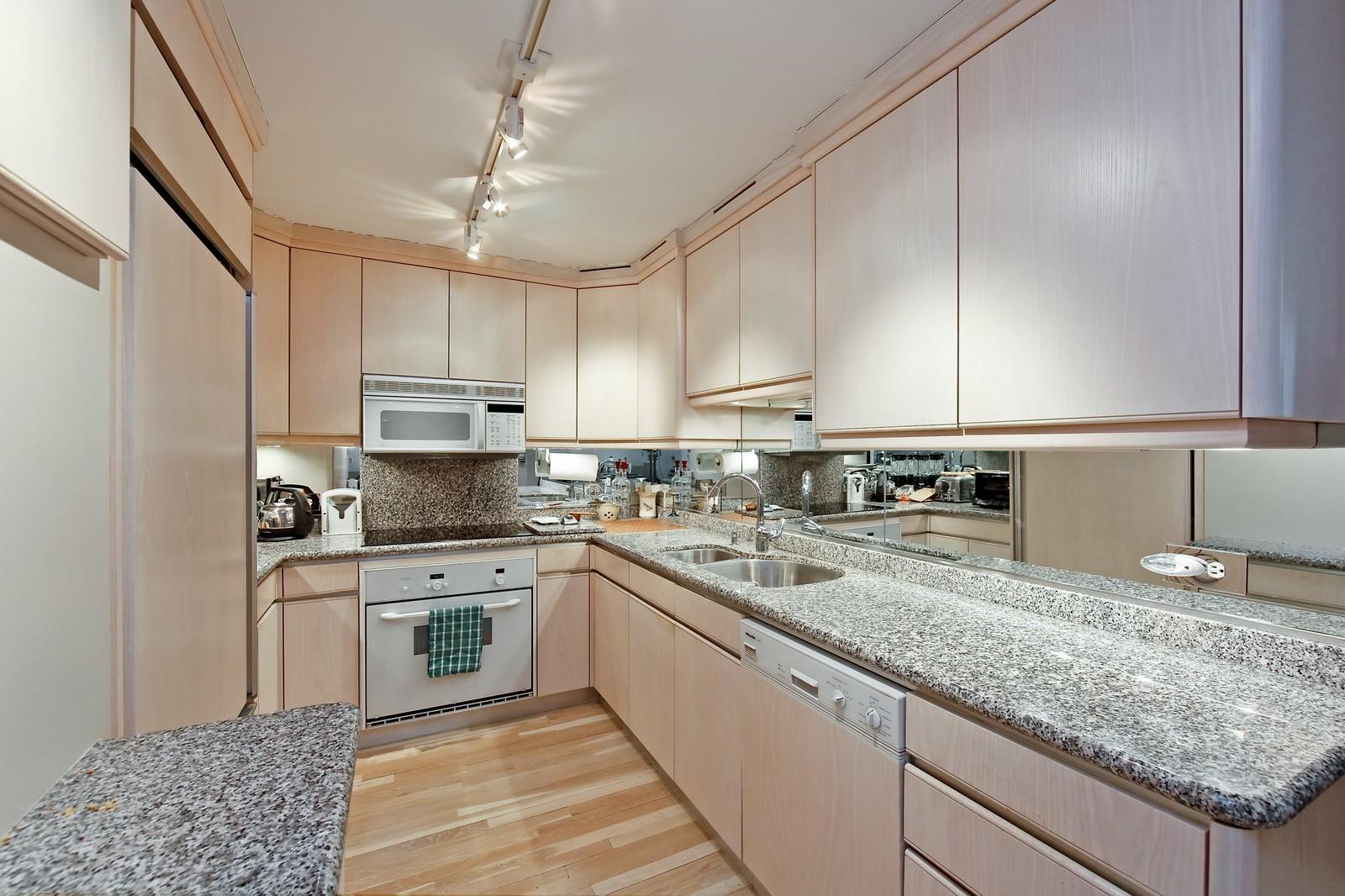 Real Estate Photography - 200 E Delaware Pl, 25F, Chicago, IL, 60611 - Kitchen