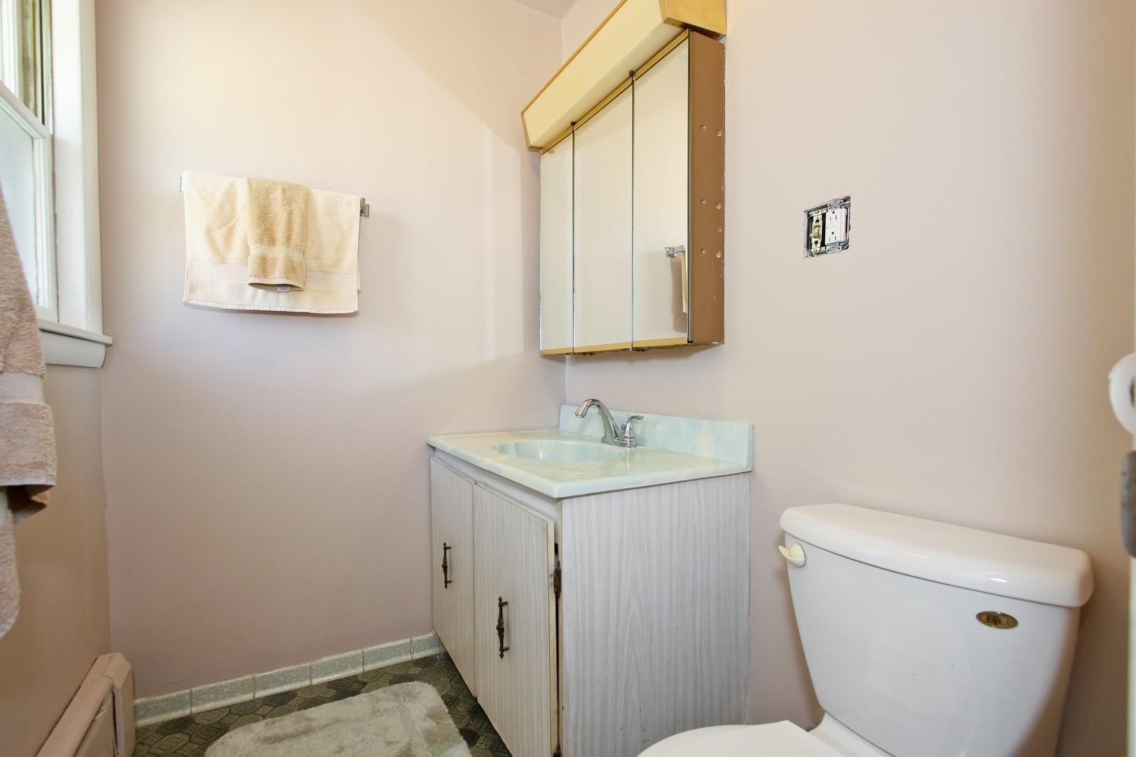 Real Estate Photography - 7431 S Roberts Rd, Bridgeview, IL, 60455 - Half Bath