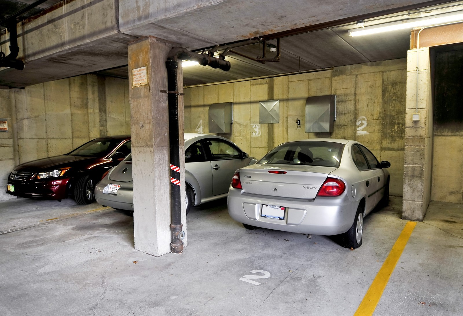 Real Estate Photography - 3303 S Grove Ave, Unit 404, Berwyn, IL, 60402 - Parking Garage