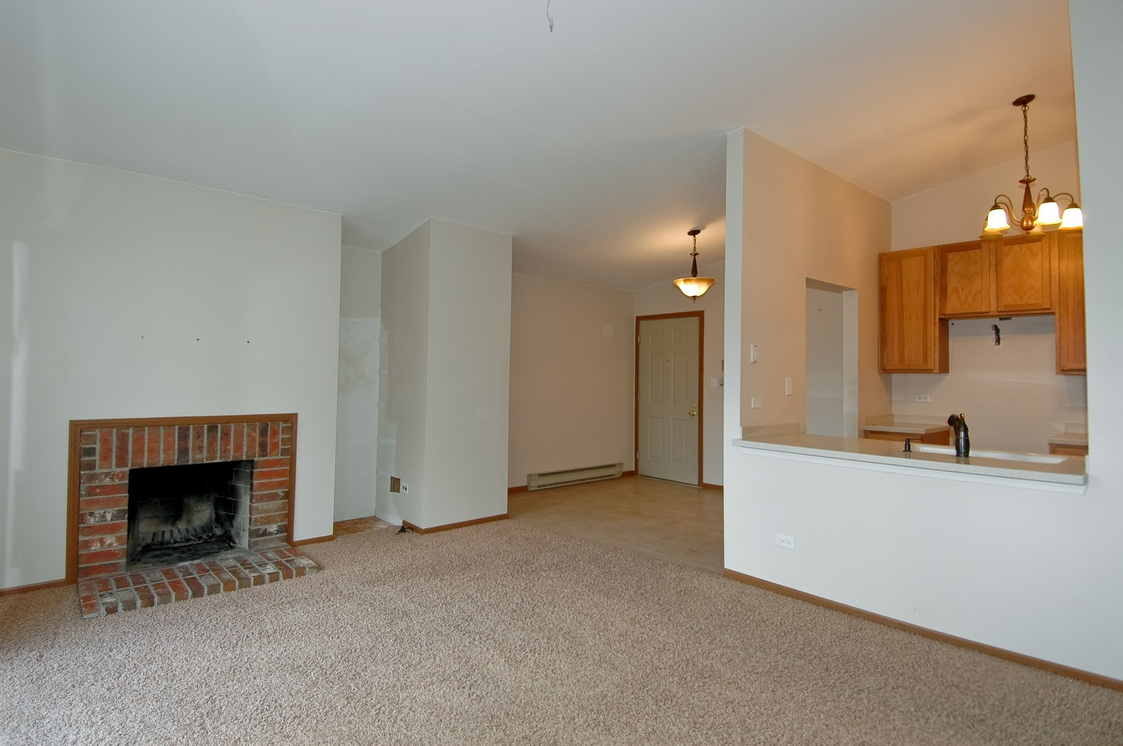 Real Estate Photography - 4314 Shamrock Ln, Unit 3B, McHenry, IL, 60050 - Kitchen / Living Room