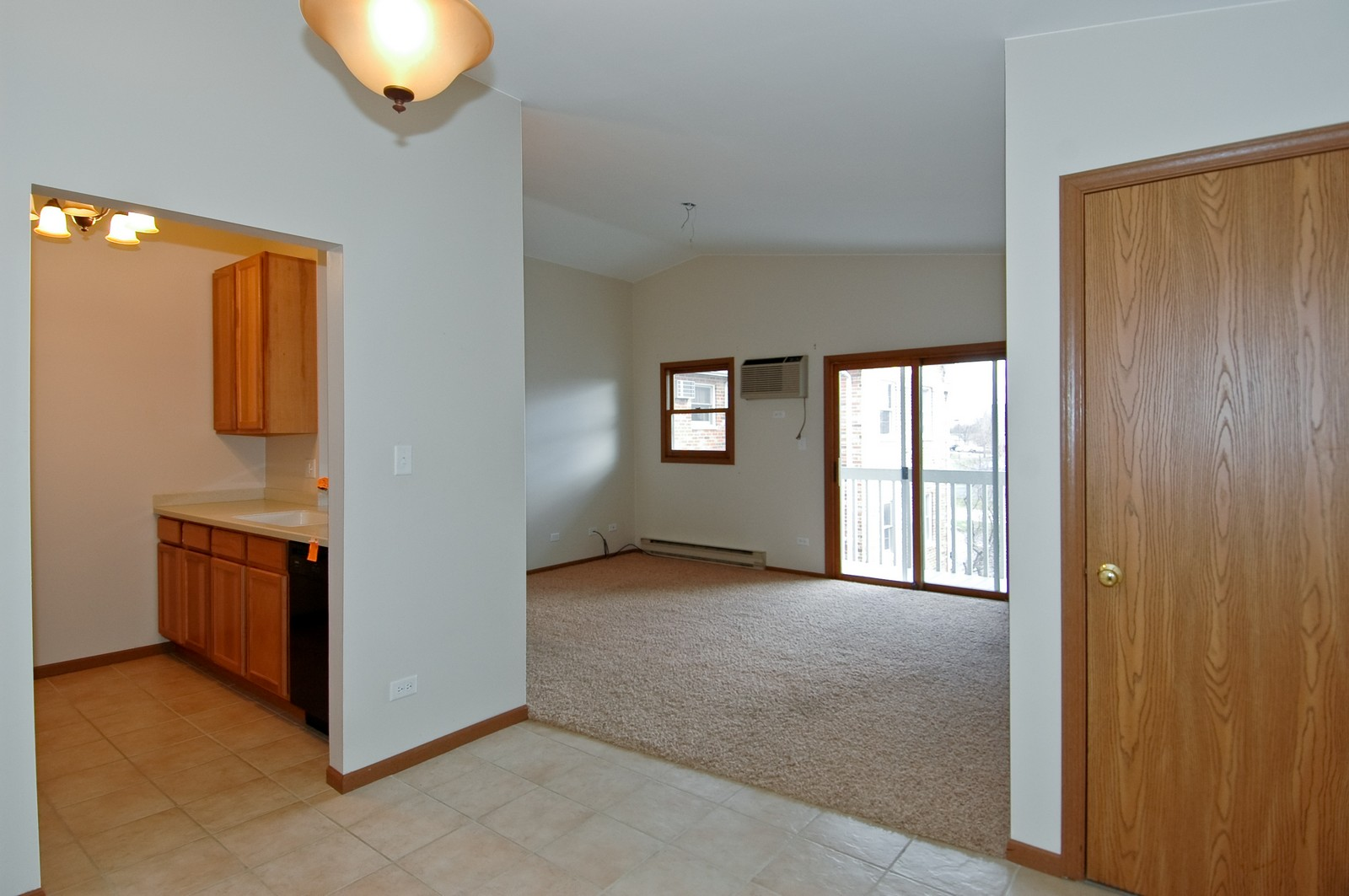 Real Estate Photography - 4314 Shamrock Ln, Unit 3B, McHenry, IL, 60050 - Living Room / Dining Room