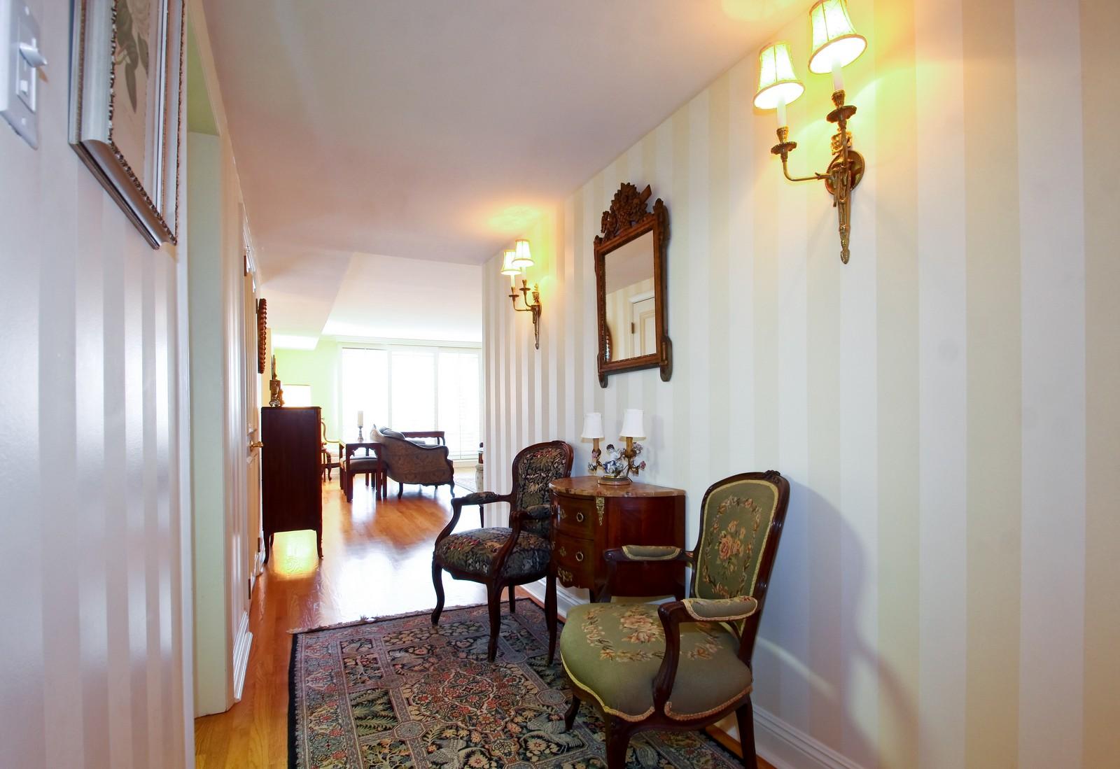 Real Estate Photography - 640 Winnetka Mews, Unit 105, Winnetka, IL, 60093 - Foyer