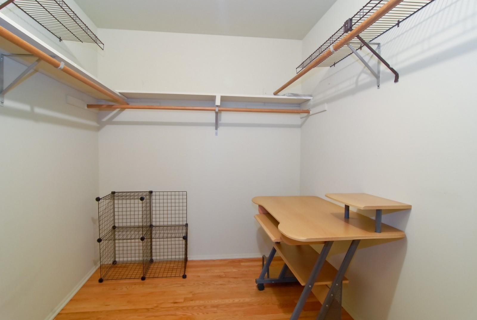 Real Estate Photography - 800 Washington Blvd, Unit 402, Oak Park, IL, 60302 - Master Bedroom Closet
