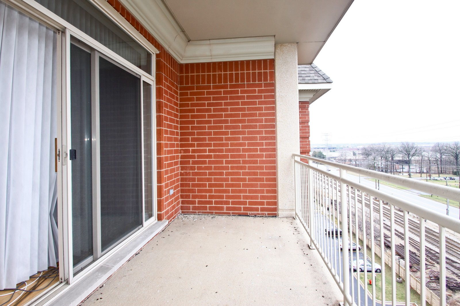 Real Estate Photography - 8400 Callie Ave, Unit 604, Morton Grove, IL, 60053 - Balcony