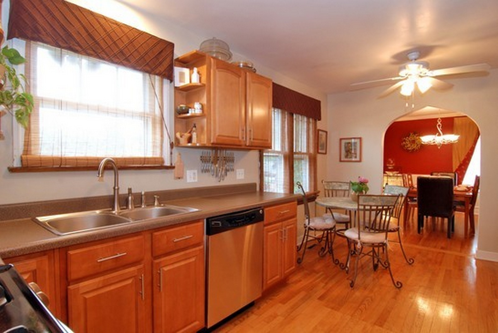 Real Estate Photography - 4244 N Lindley St, Downers Grove, IL, 60515 - Kitchen shown with eating space