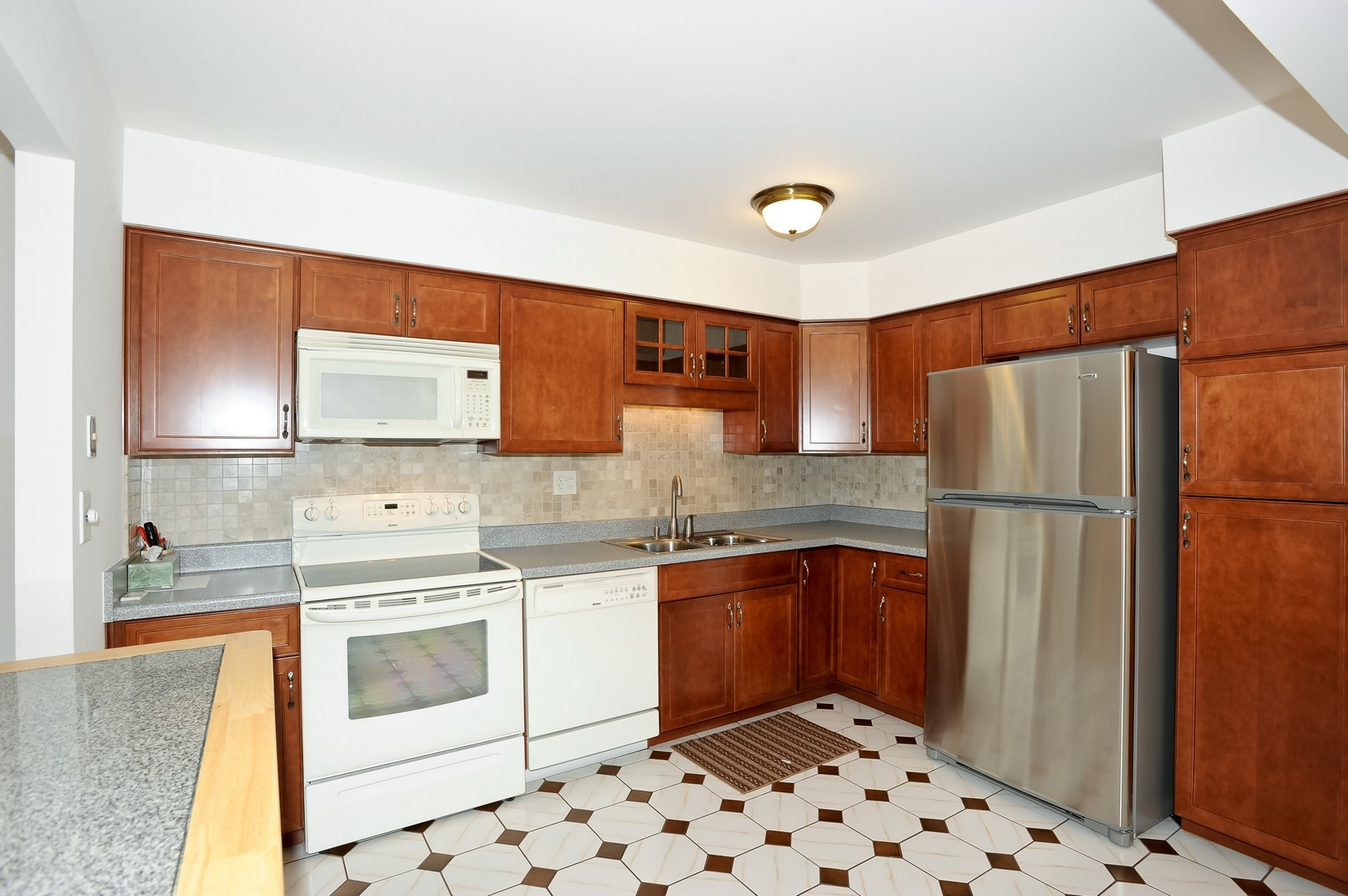 Real Estate Photography - 1105 N Mill St, Unit 217, Naperville, IL, 60563 - Kitchen