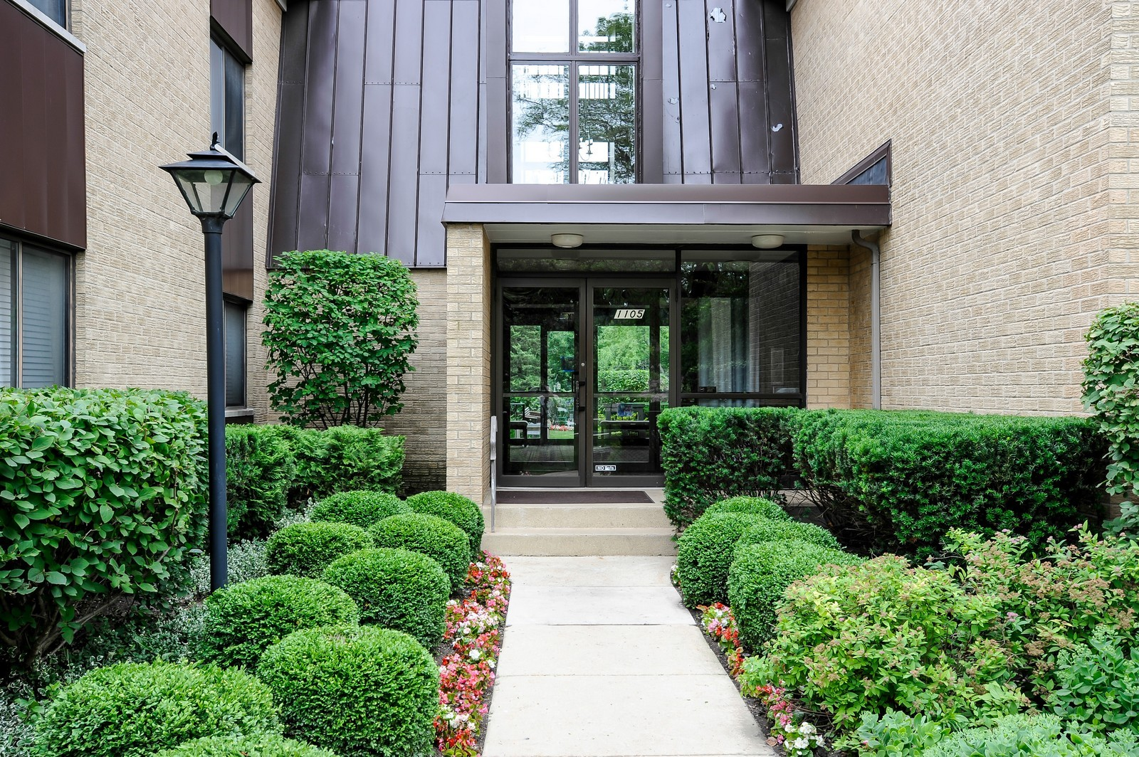 Real Estate Photography - 1105 N Mill St, Unit 217, Naperville, IL, 60563 - Front View
