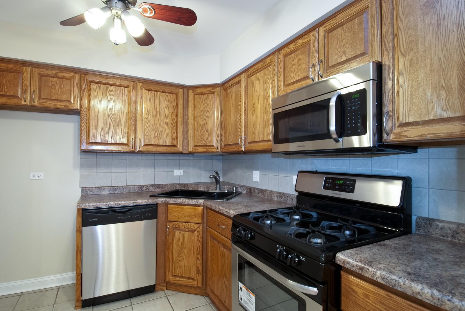 Real Estate Photography - 550 E Main St, Unit 2C, Barrington, IL, 60010 - Kitchen