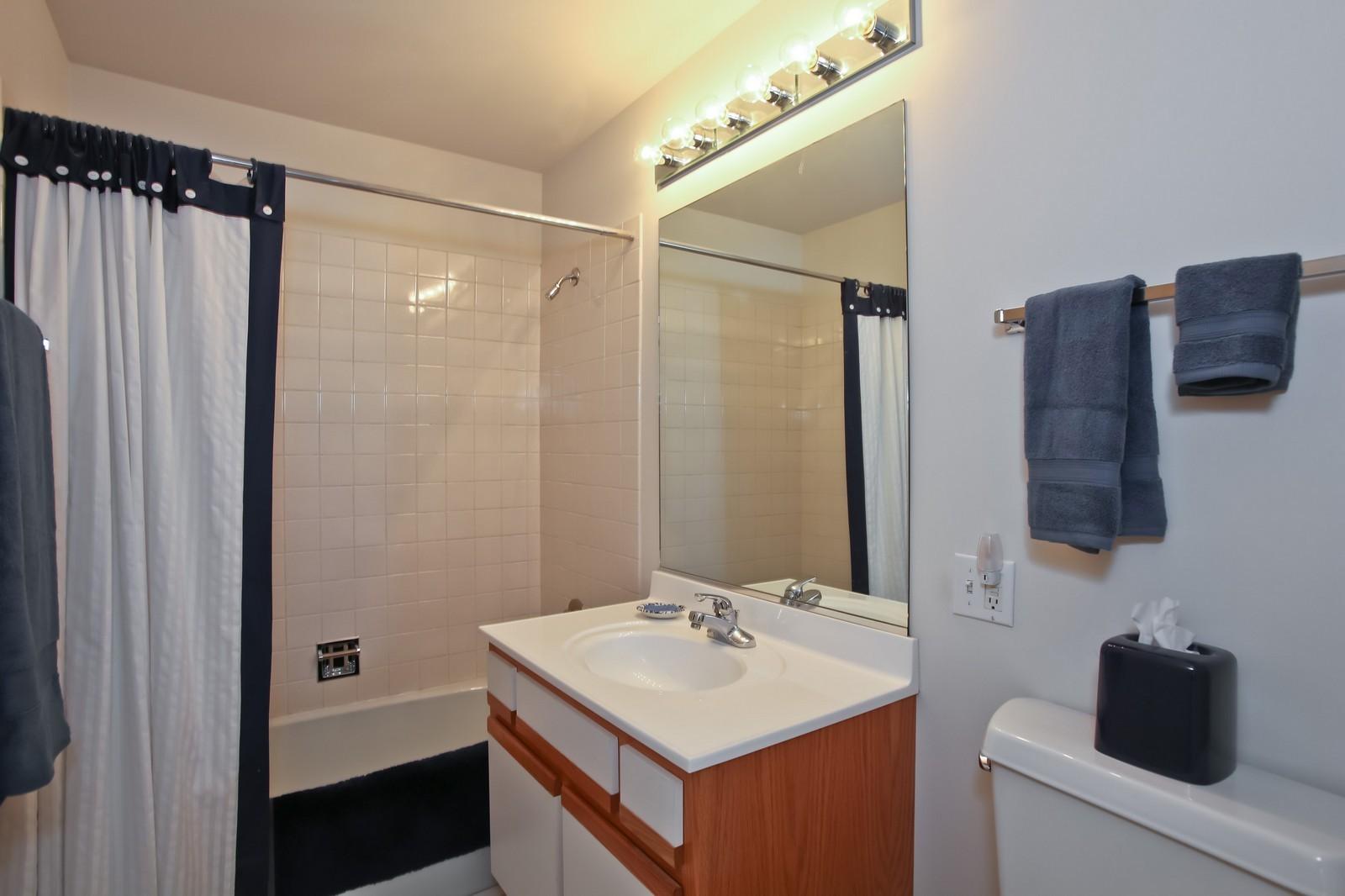 Real Estate Photography - 519 N Main St, Unit 2DN, Glen Ellyn, IL, 60137 - Hall Bath
