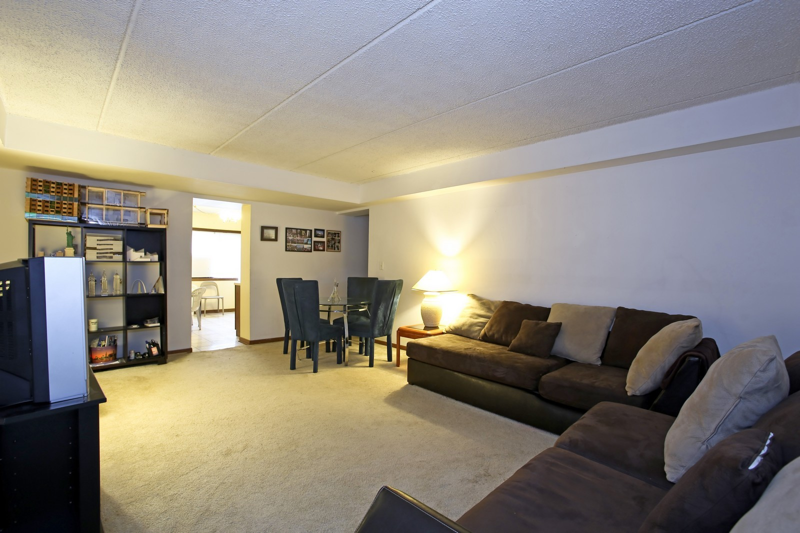 Real Estate Photography - 4946 Douglas Rd, Unit 102, Downers Grove, IL, 60515 - Living Room