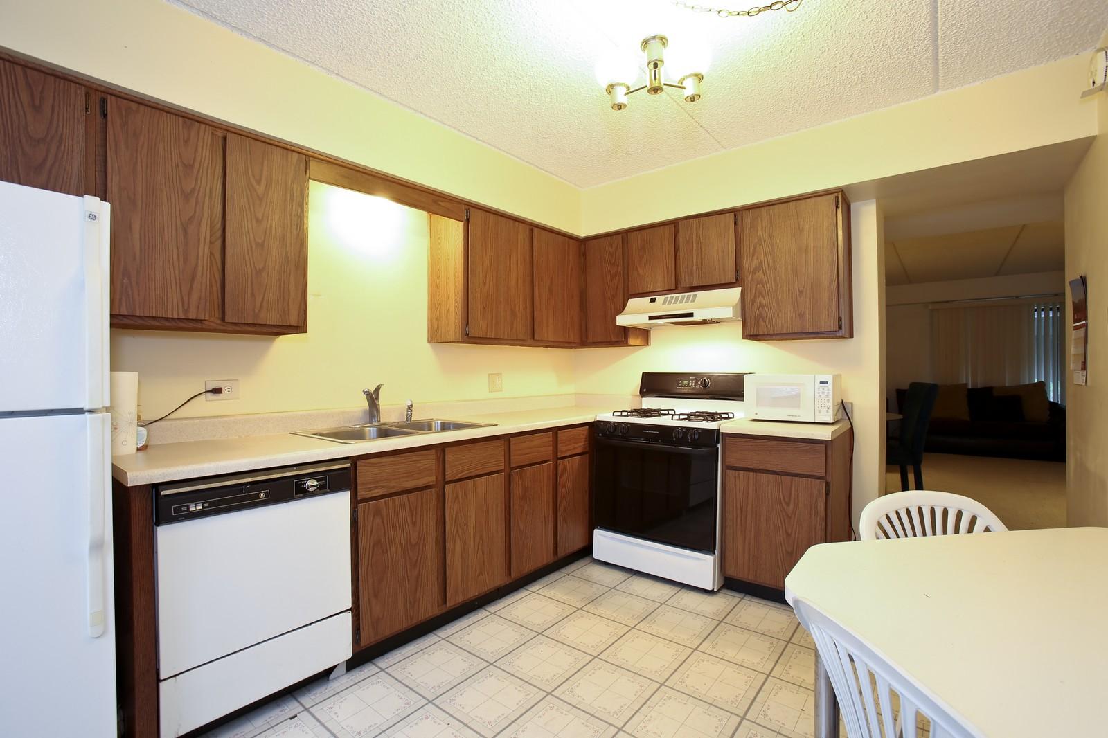 Real Estate Photography - 4946 Douglas Rd, Unit 102, Downers Grove, IL, 60515 - Kitchen