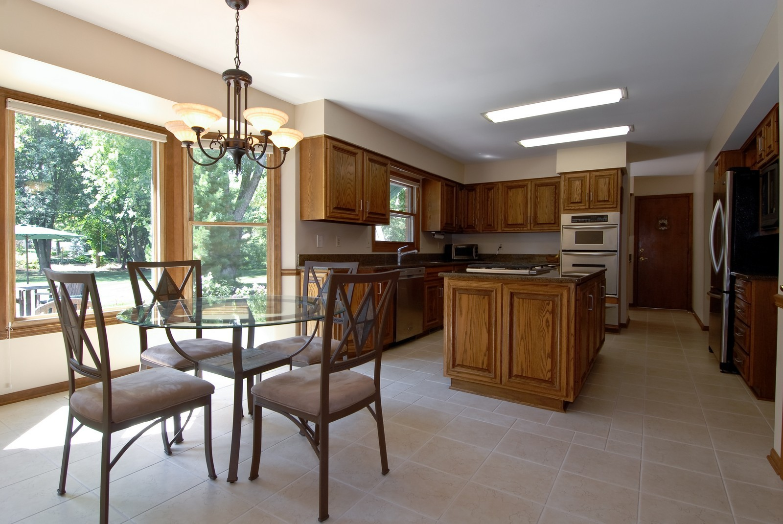 Real Estate Photography - 335 Persimmon Dr, St Charles, IL, 60174 - Kitchen / Breakfast Room
