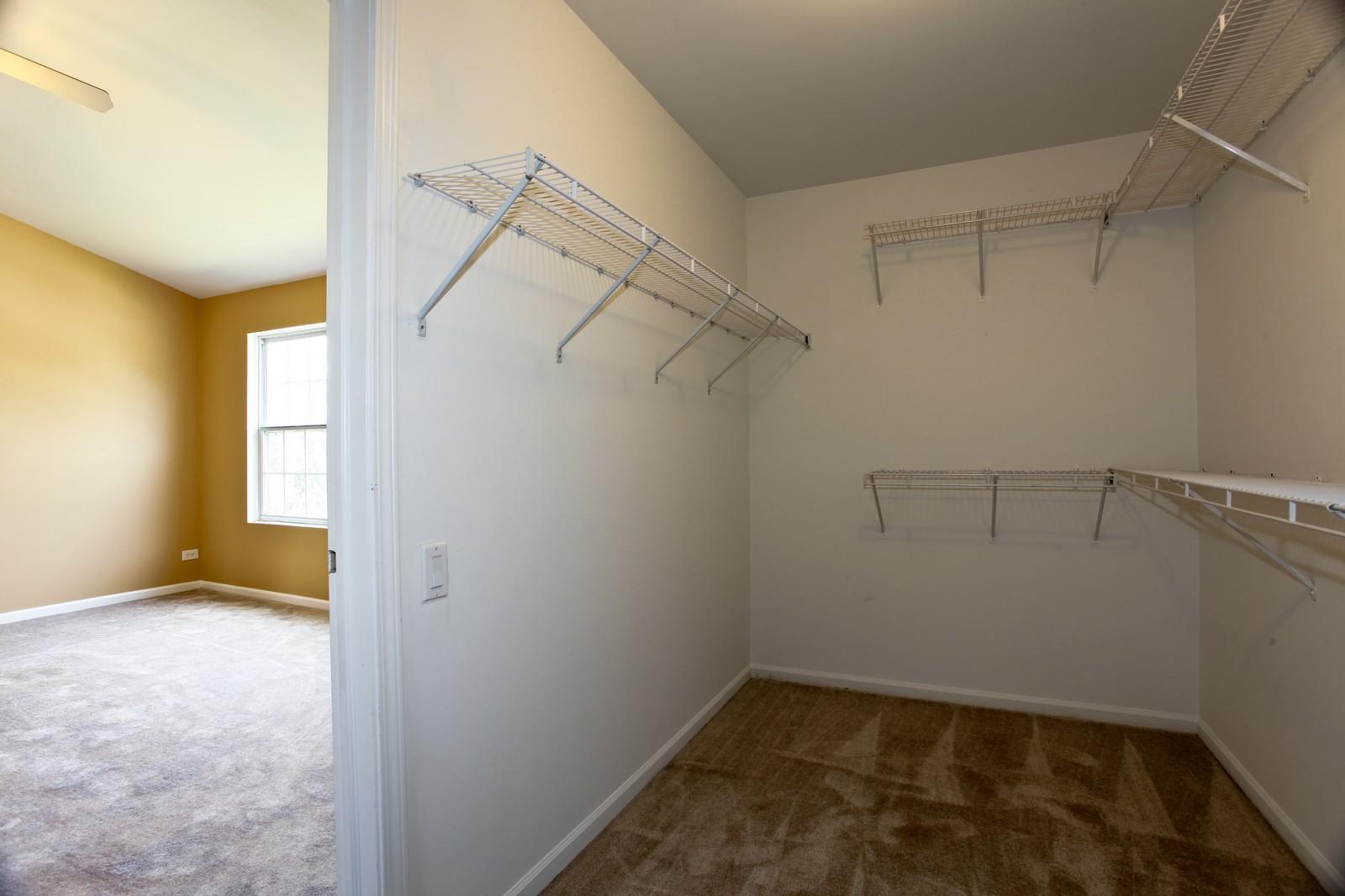 Real Estate Photography - 114 Oakton Dr, Lombard, IL, 60148 - Master Bedroom Closet