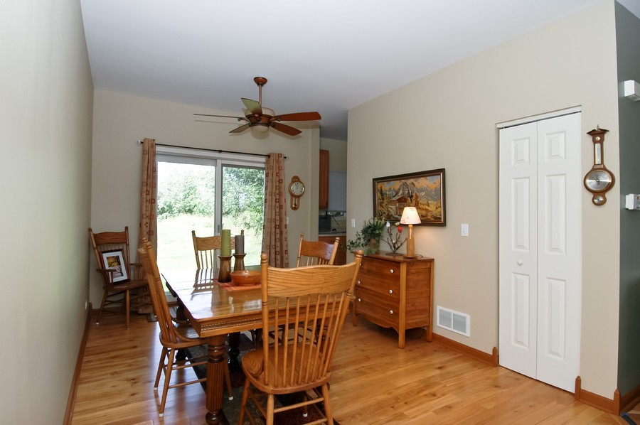 Real Estate Photography - 9165 Falcon Greens Dr, Lakewood, IL, 60014 - Dining Room