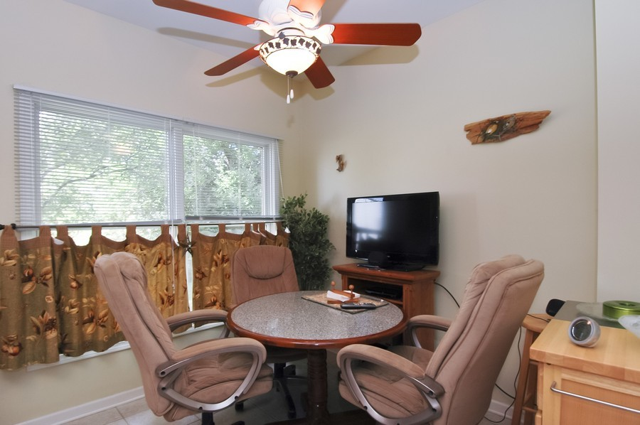 Real Estate Photography - 9165 Falcon Greens Dr, Lakewood, IL, 60014 - Dining Area