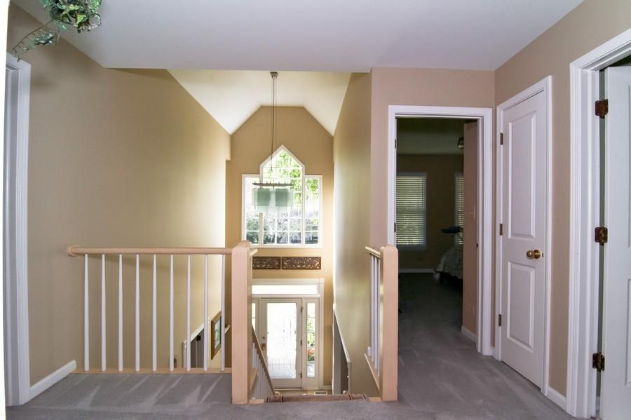 Real Estate Photography - 6521 Greene Rd, Woodridge, IL, 60517 - 2nd Floor Corridor