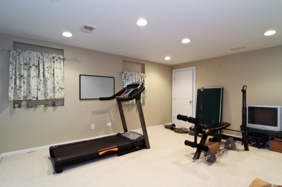 Real Estate Photography - 6521 Greene Rd, Woodridge, IL, 60517 - Fitness Room