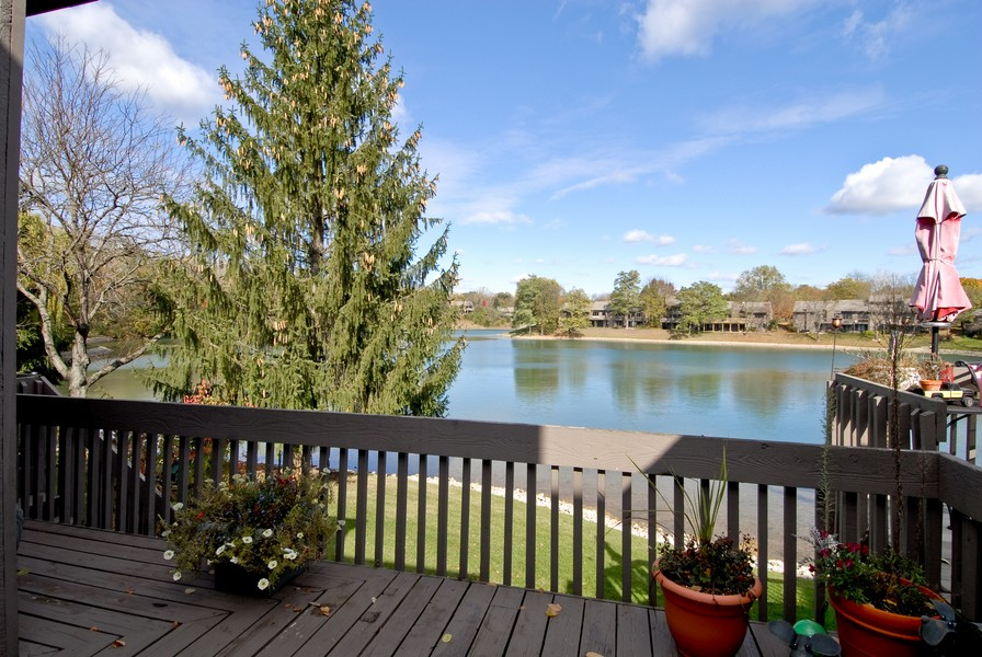 Real Estate Photography - 12 Lakewood Cir, 12, St. Charles, IL, 60174 - Deck with gorgeous lake view