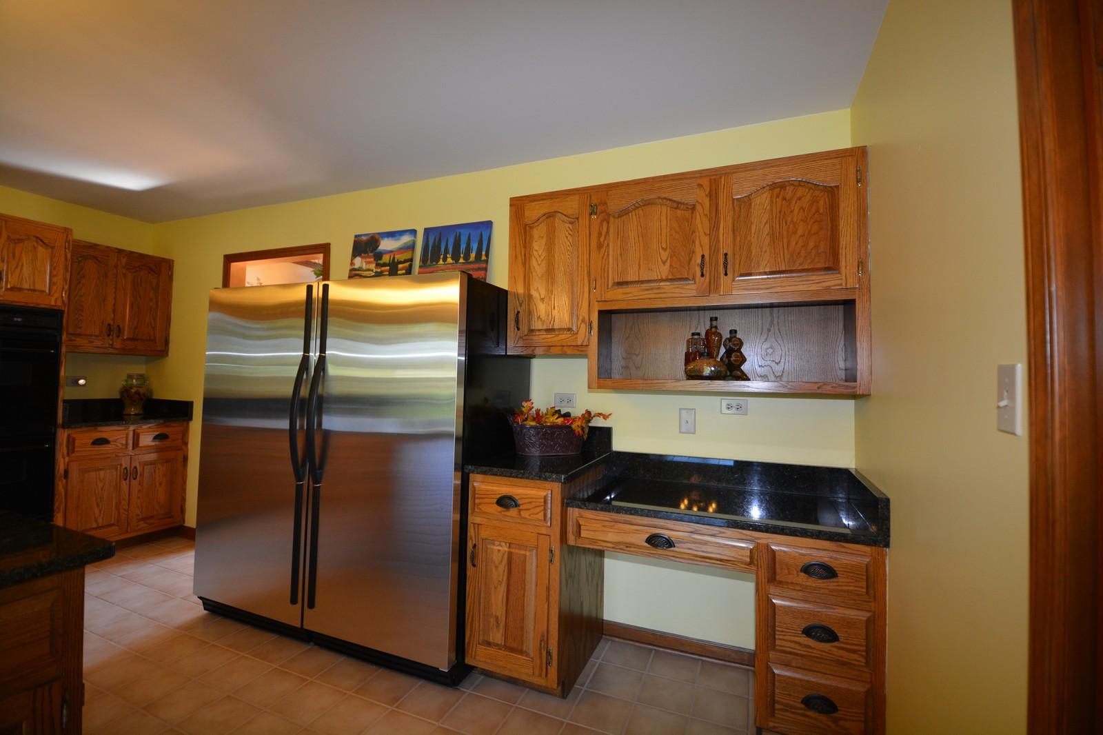 Real Estate Photography - 24060 Royal Worlington Dr, Naperville, IL, 60564 - Kitchen Planning Desk