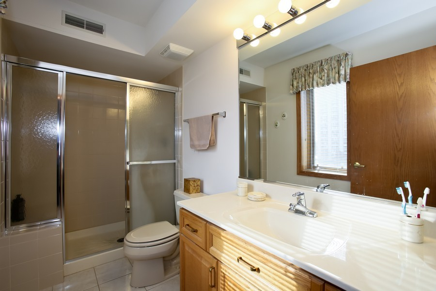 Real Estate Photography - 100 N Gary Ave, Unit 409, Wheaton, IL, 60187 - Master Bathroom